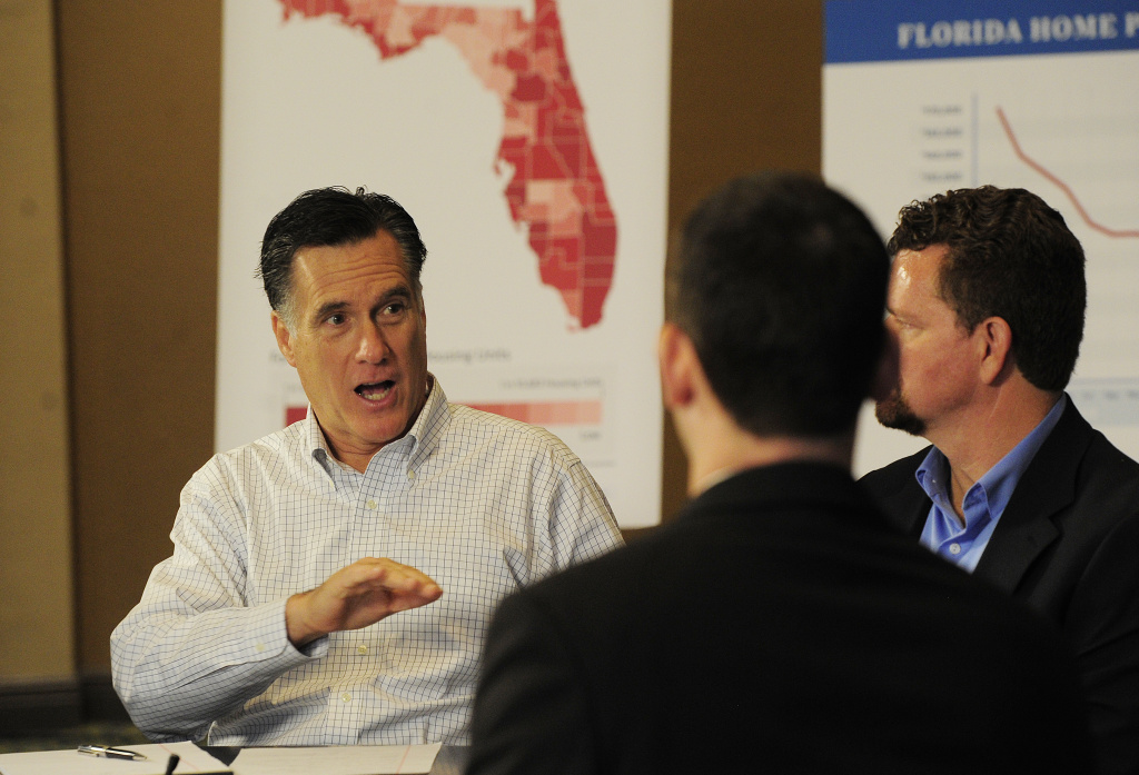 Republican presidential hopeful Mitt Romney holds a round table on housing issues in Tampa, Florida, January 23, 2012.