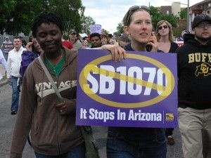 A protester holds a union anti-SB 1070 sign, May 1, 2010