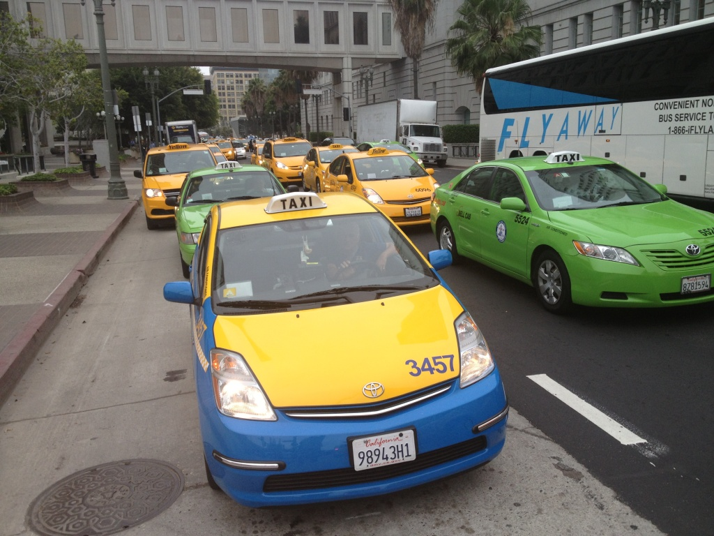 Taxicabs circled L.A. City Hall to protest against ride-sharing services in late June.