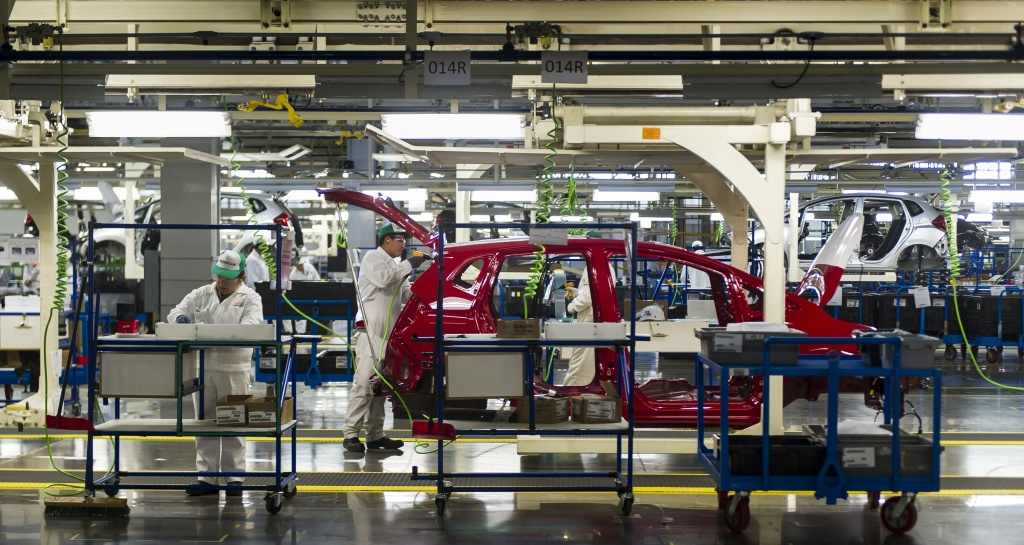 Workers at the assembly line of the recently opened Honda Motors factory in Celaya, Guanajuato state, Mexico, on February 21, 2014. As more car companies move to Mexico, the company could become the next Detroit.