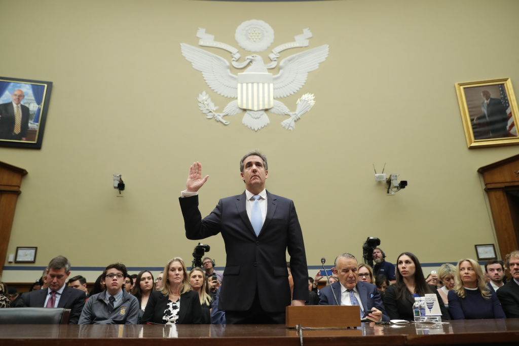 Michael Cohen, former attorney and fixer for President Donald Trump is sworn in before testifying before the House Oversight Committee on Capitol Hill February 27, 2019 in Washington, DC.
