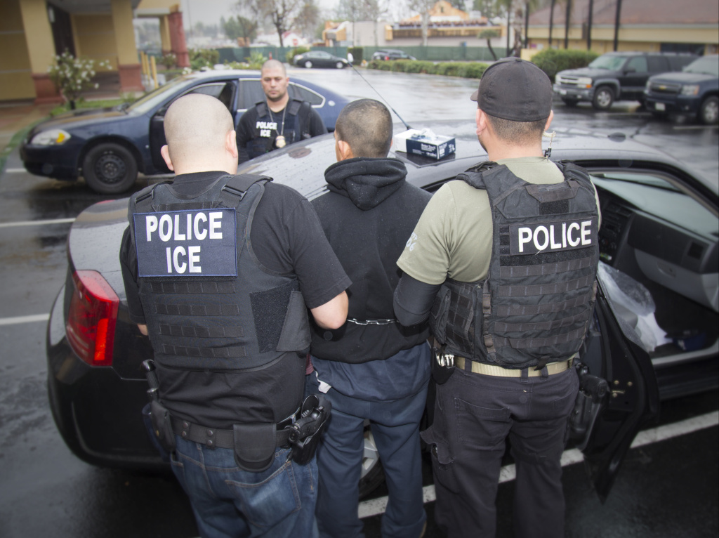 In this Tuesday, Feb. 7, 2017, photo released by U.S. Immigration and Customs Enforcement shows foreign nationals being arrested during a targeted enforcement operation conducted by U.S. Immigration and Customs Enforcement (ICE) aimed at immigration fugitives, re-entrants and at-large criminal aliens in Los Angeles.