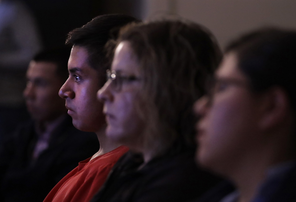 Victor Guzman, an undocumented resident, watches President Donald Trump speak during a State of the Union watch party Tuesday in Chicago.