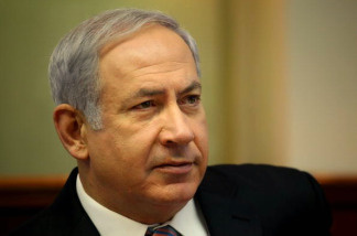 Israeli Prime Minister Benjamin Netanyahu opens the weekly cabinet meeting at his Jerusalem office.