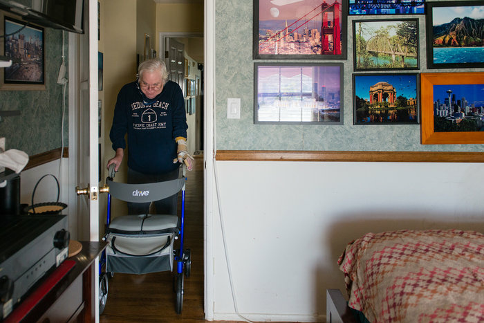 Campbell is able to move around his house with the help of a walker.