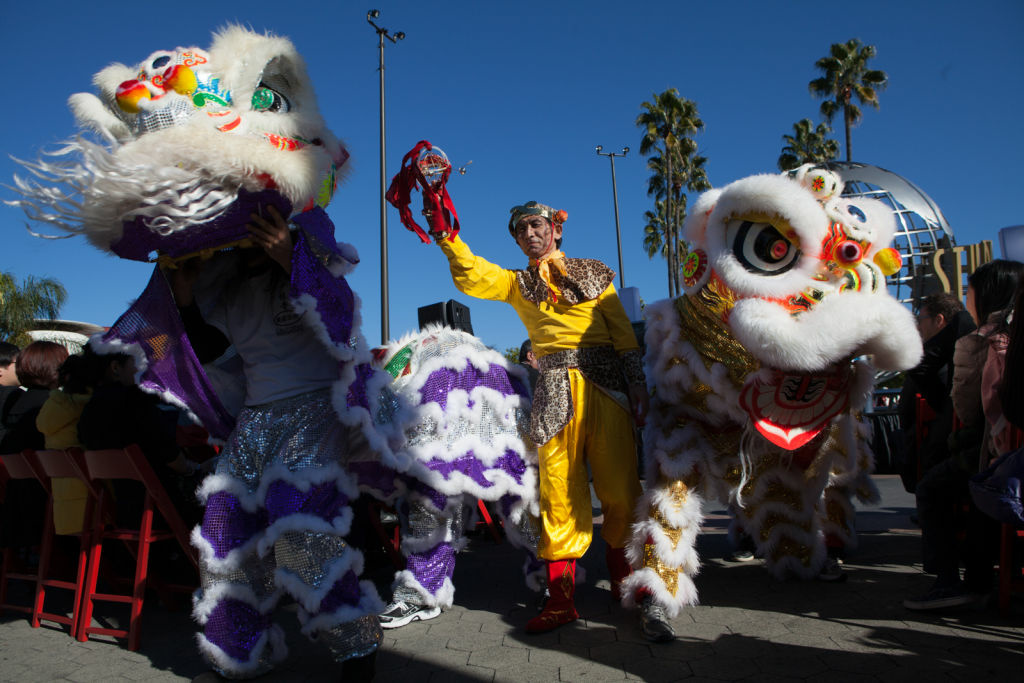 Lions dance at the opening of the Beijing Municipal Commission of Tourism Development's Culture Fair at Universal Studios Hollywood On January 4th, 2012.