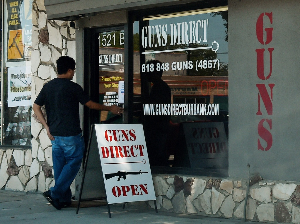 A man enters a gun store in Los Angeles, California in August, 2015.