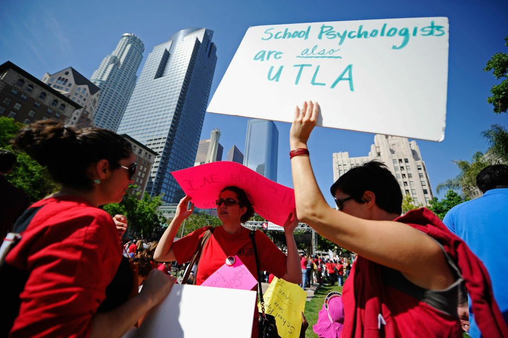 School psychologists (L-R) Jimena Delpozo, Lynn Elias and Diana Socier take part in an education budget cuts rally and protest at Pershing Square on May 13, 2011 in downtown Los Angeles, California.