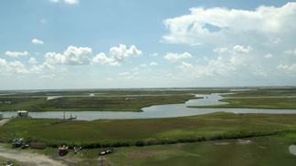 A Love-Hate History: Oil And Fishing In The Gulf -- Channels and bayous crisscross the marsh grasses in Cocodrie, La. Over the years, the cutting of channels for oil and gas exploration has contributed to Louisiana's receding coastline.