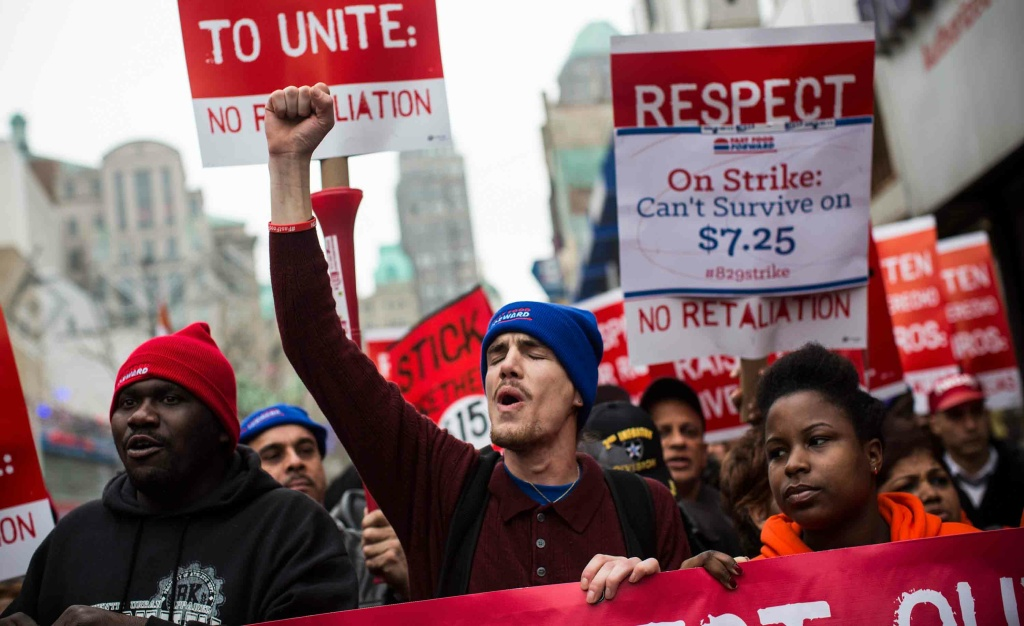 Protesters rally outside of a Wendy's in support of raising fast food wages from $7.25 per hour to $15.00 per hour on December 5, 2013 in the Brooklyn borough of New York City. A growing number of fast food workers in the United States have been staging protests outside restaurants, calling for a raise in wages, claiming it is impossible to live reasonably while earning minimum wage.
