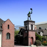 Kermit the Frog sit atop the entry gates to the Jim Henson Company studios.