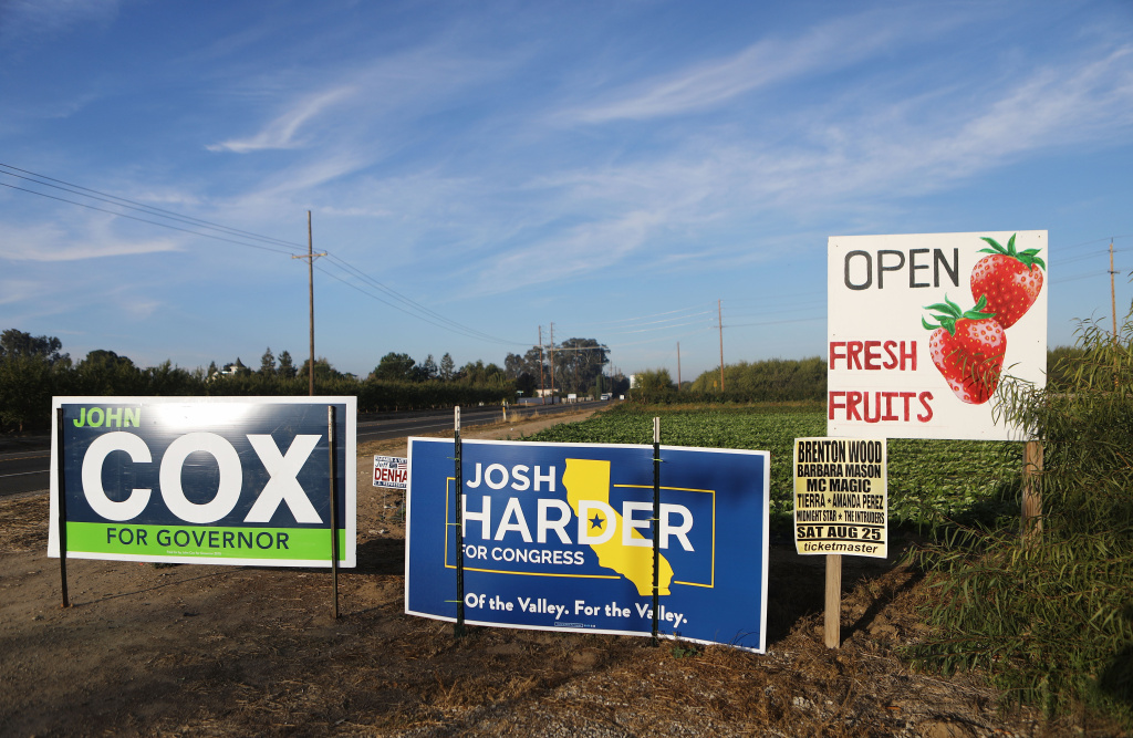 Candidate signs stand next to a fruit stand on October 24, 2018 in Modesto, California.