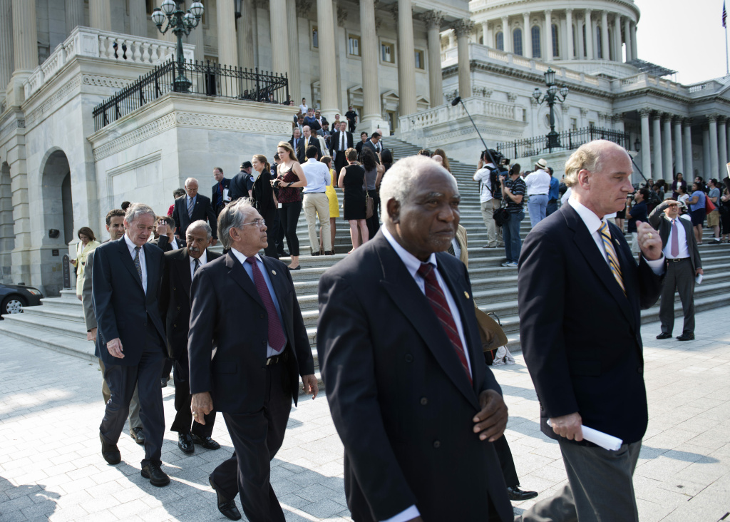 House Democrats walk out of the US Capitol building during votes in protest June 28, 2012 in Washington, DC. Members of the Congressional Black Caucus and other House Democrats walked out to protest the US House of Representative's vote to hold US Attorney General Eric H. Holder Jr. in contempt of Congress for his testimony and cooperation with Congress revolving around the Justice Department's 'fast and furious' program.