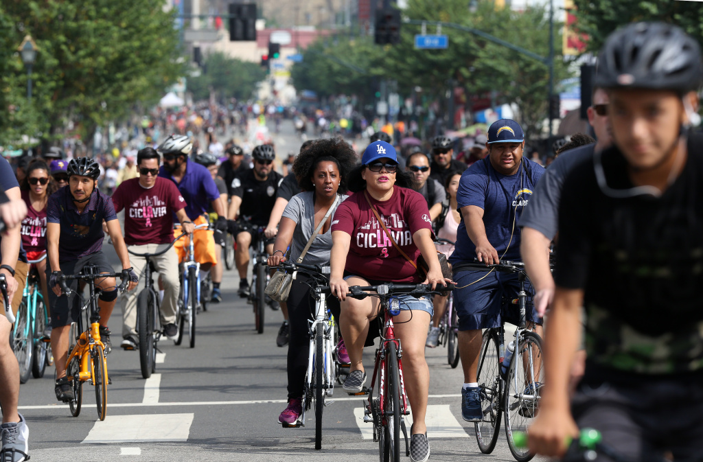 FILE PHOTO: Cyclists ride the open streets in downtown Los Angeles on Sunday, Oct. 18, 2015. Six miles of streets in and around downtown Los Angeles were closed to motor vehicles as the CicLAvia festival opened the car-free lanes to cyclists, skaters and pedestrians.