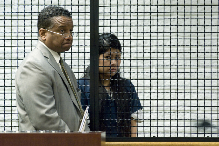 Defendants Candace Brito, left, and Vanesa Zavala enter a Santa Ana, Calif., courtroom Tuesday, July 22, 2014. Attorneys began closing arguments in the case against the women who are facing charges relating to the beating death of 23-year-old Annie Kim Pham.