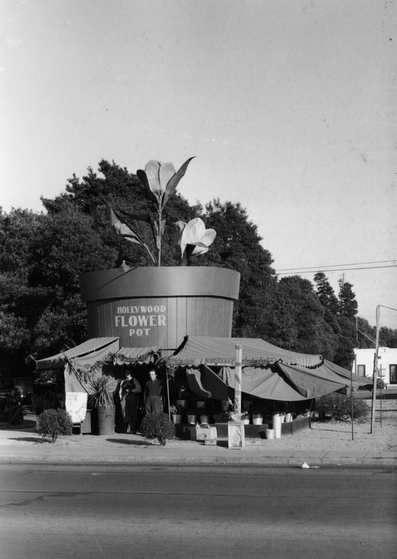 Located at 1124 Vine St. in Hollywood, the Hollywood Flower Pot is both the name of this flower shop and an accurate description of its facade. (1930) (Photo via Los Angeles Public Library Collection)
