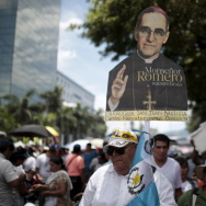 A man holds an image of late Archbishop of San Salvador Oscar Arnulfo Romero during his beatification ceremony at El Salvador del Mundo square in San Salvador, today.