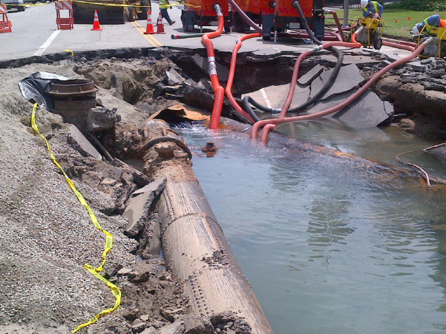 Crews working to repair water mains in a photo released Wednesday, July 30, 2014.