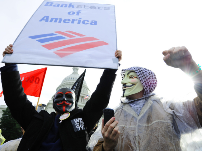 Occupy D.C. protesters chant slogans against Bank of America during a Jan. 17 demonstration in front of the U.S. Capitol for an