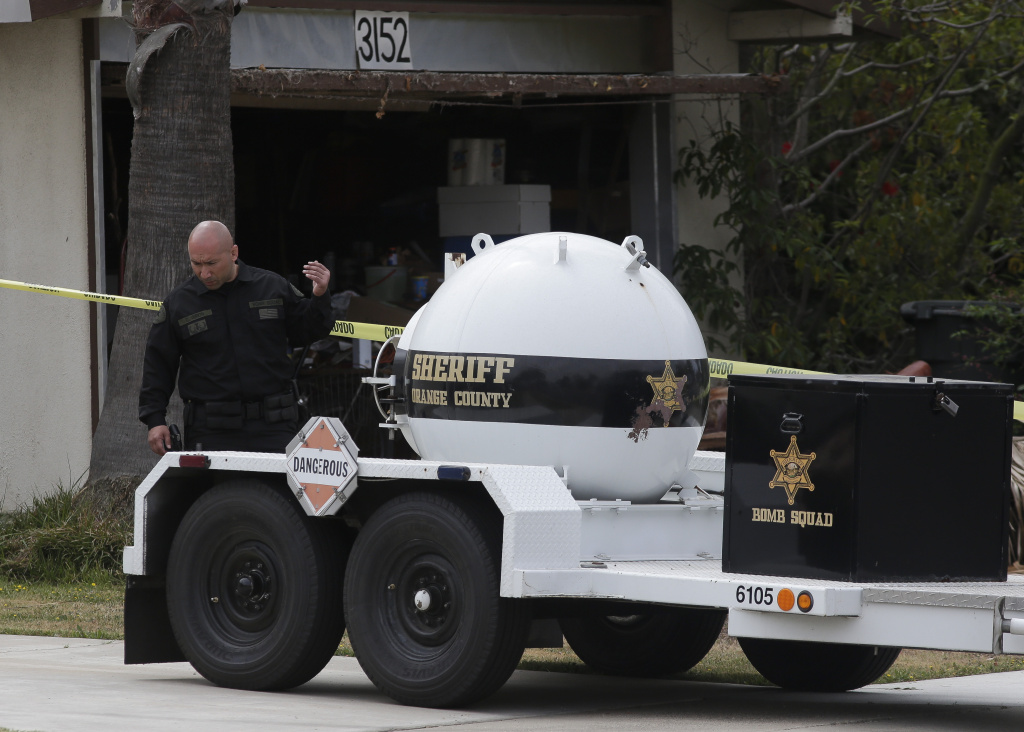 A bomb disposal vehicle is seen in front of a home where a man died in a Sunday night blast, in Costa Mesa, Calif., Monday, April 15, 2013. A man was blown up in his California home and at least 16 neighbors were evacuated as authorities found and destroyed other explosive devices, police said Monday.