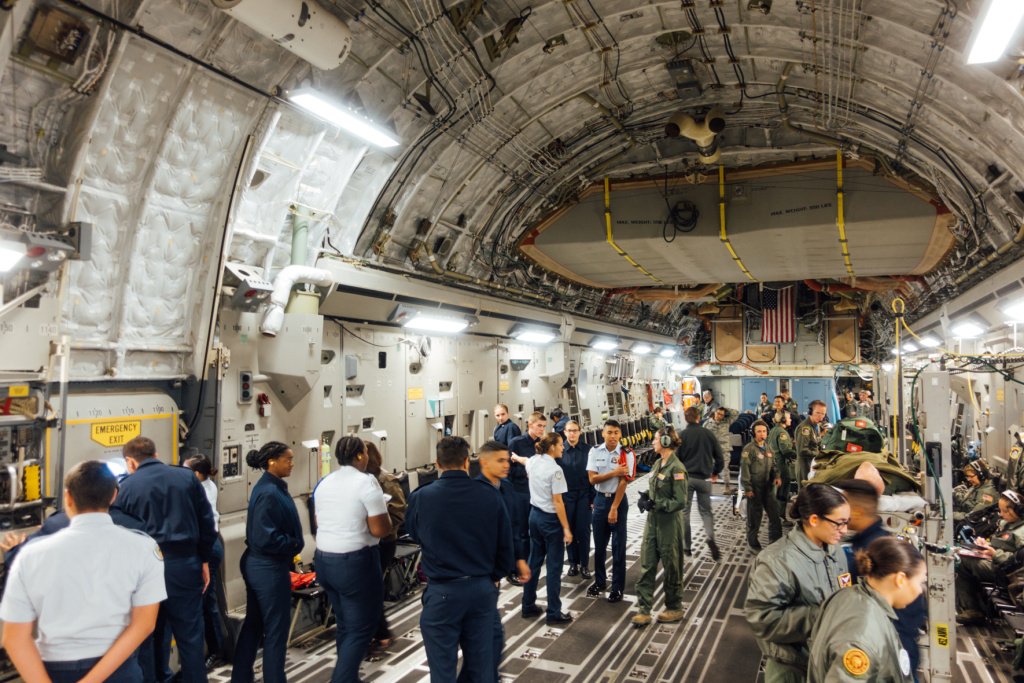 Air Force Junior Reserve Officer Training Corps cadets and Airmen participating in an aeromedical evacuation proficiency training mission aboard a Boeing C-17.