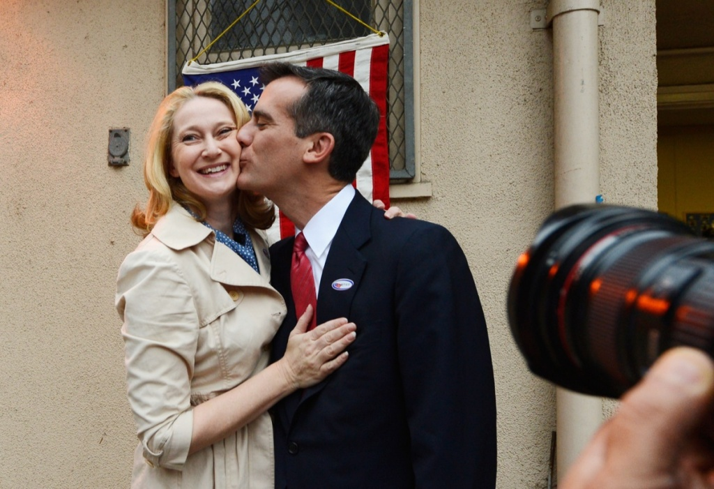Candidate in the Los Angeles City mayoral race, Councilman Eric Garcetti kisses his wife Amy Wakeland after they voted at Allesandro Elementary School on March 5, 2013 in the Boyle Heights area of Los Angeles.