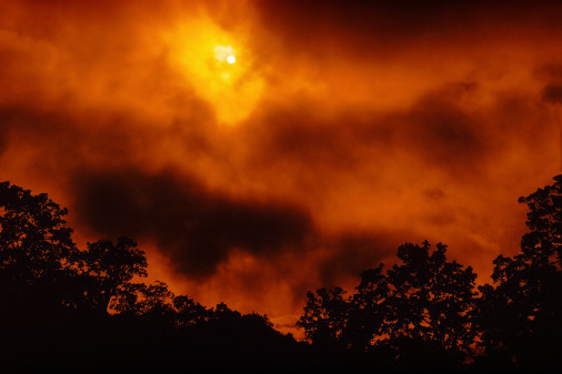 A forest fire obscures the sun during the Marble Cone Fire in Carmel Valley, California.