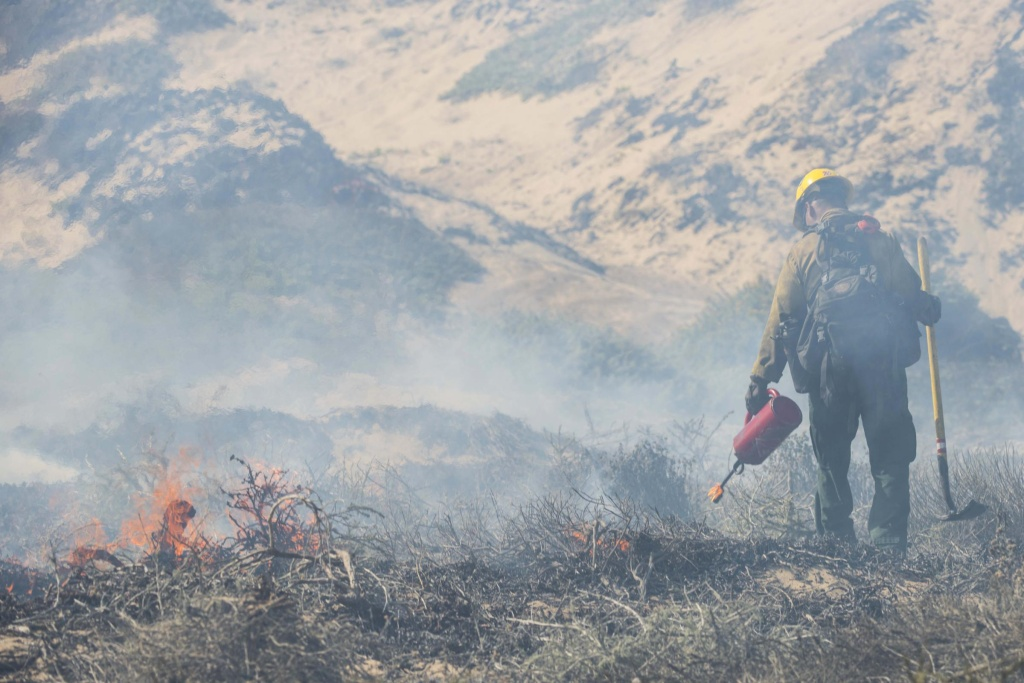 A fire fighter monitors a controlled burn Sept. 18, 2019 at Vandenberg Air Force Base. The burn was intended to reduce the risk of wildfires.