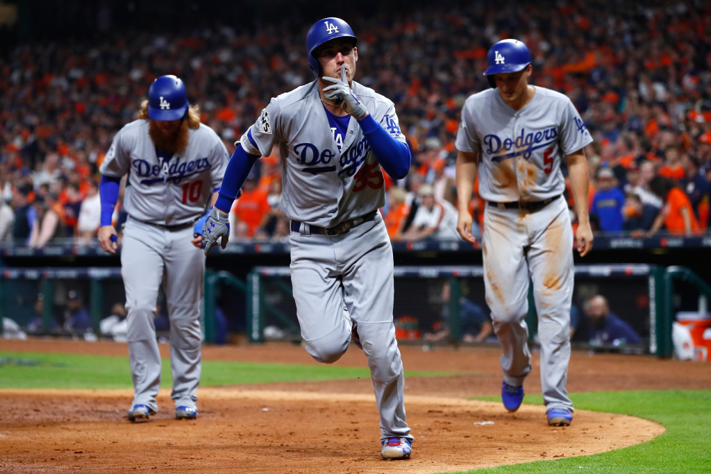 Cody Bellinger of the Los Angeles Dodgers celebrates with Corey Seager and Justin Turner after hitting a three-run home run during the fifth inning against the Houston Astros.