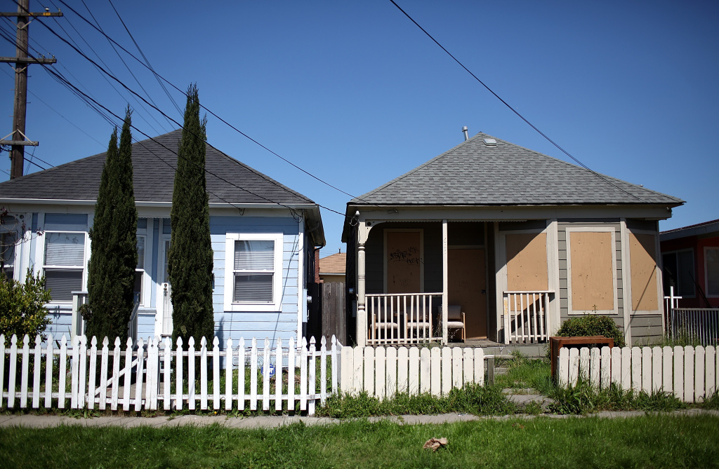 In this file photo, a boarded up home is seen on April 6, 2011 in Richmond, California.