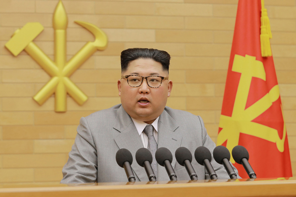 This picture from North Korea's official Korean Central News Agency (KCNA) taken and released on January 1, 2018 shows North Korean leader Kim Jong-Un delivering a New Year's speech at an undisclosed location.