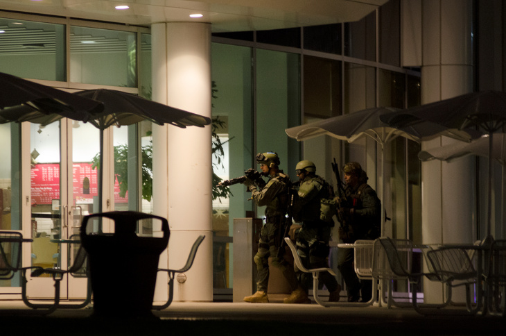 SWAT prepares to enter Mihyalo Hall at Cal State Fullerton in Fullerton, Calif., Wednesday, Dec. 12, 2012. One of five roberry suspects, believed to be armed, has barracaded himself inside the building.
