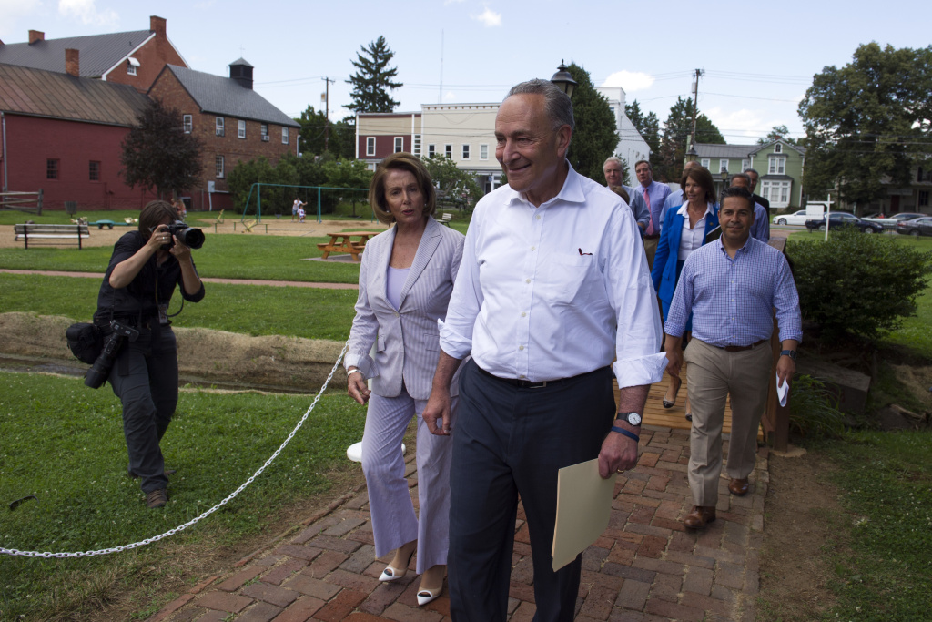 Senate Minority Leader Chuck Schumer of N.Y. and House Minority Leader Nancy Pelosi of Calif. lead Congressional Democrats to a news conference to unveil their new agenda, Monday, July 24, 2017, in Berryville, Va. House and Senate Democrats are offering a retooled message and populist agenda, promising to working Americans