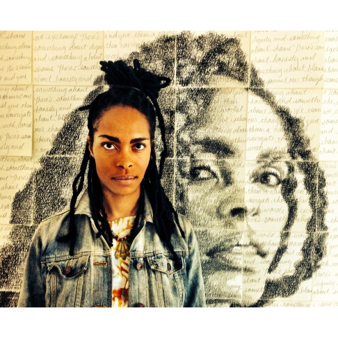 Kenturah Davis with her self-portrait at Papillion Art in Leimert Park in South LA.