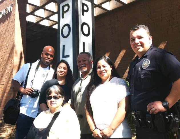 The Banks/Padilla/Mendoza family gathered at the Hollywood LAPD station after the dedication of the Miguel Leonard Padilla Banks soft room. L-R (standing) Darnell Banks, Xiomara Padilla-Banks, Miguel Padilla, Adriana and Jorge Mendoza; (sitting) Hilda Pad