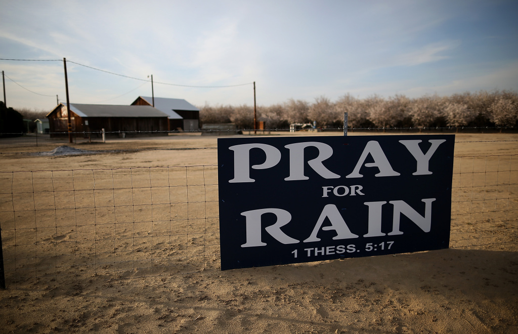 A sign is posted near an almond farm on February 25, 2014 in Turlock, California. Farmers in at least two nearby irrigation districts are considering whether to ignore a letter from the state calling for historic cuts in water use during the drought.