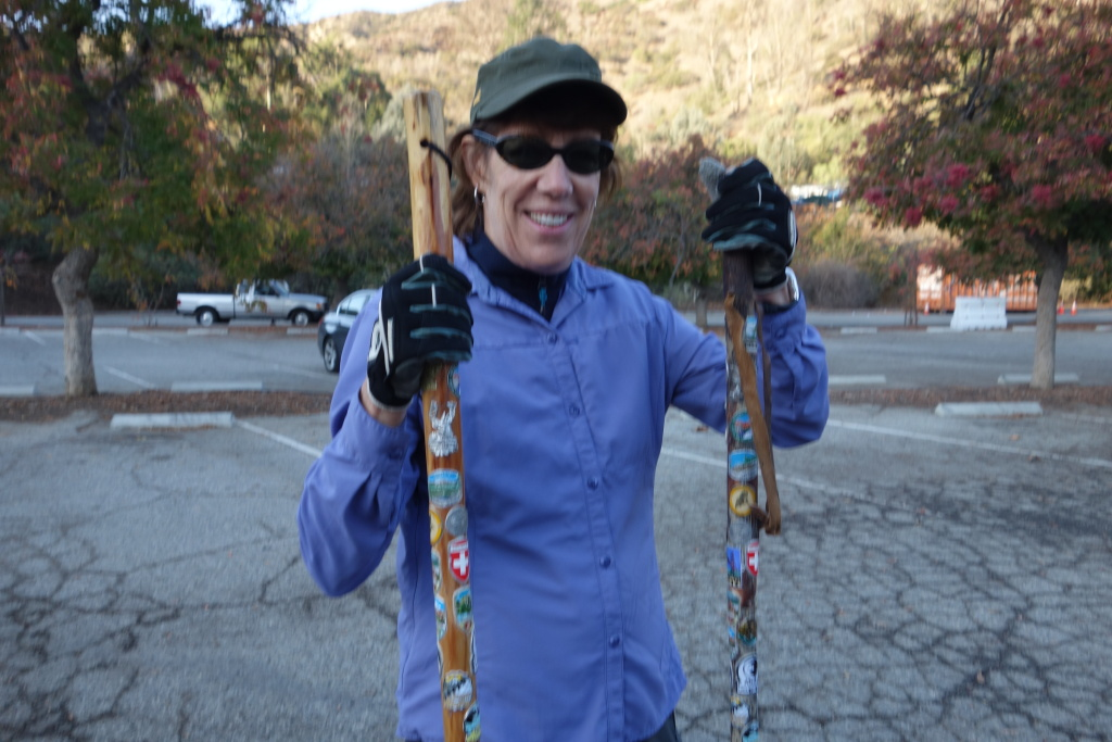 Sharon Kent holding her walking stick and that of her late husband, Phil Kent, who died in September 2016 of pancreatic cancer.