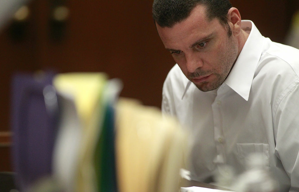 Marvin Norwood looks down at note on a table as he sits in Los Angeles Superior Court during a preliminary hearing.