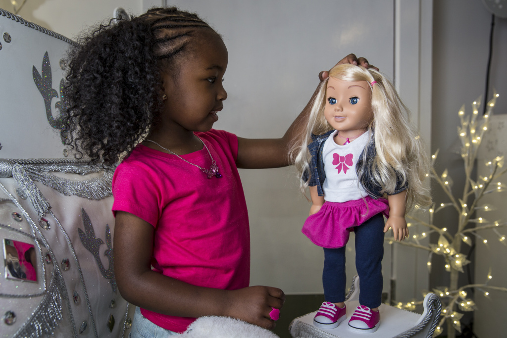 Jayla, aged 4, plays with a 'My Friend Cayla' doll in the Hamleys toy shop on June 26, 2014 in London, England. Previous research has indicated that both black and white children prefer lighter skinned dolls