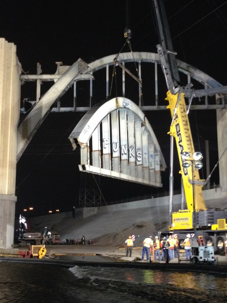 City Bureau of Engineering workers brought down the first arch of the Sixth Street Bridge in Boyle Heights late Wednesday night, Aug. 3, 2016.
