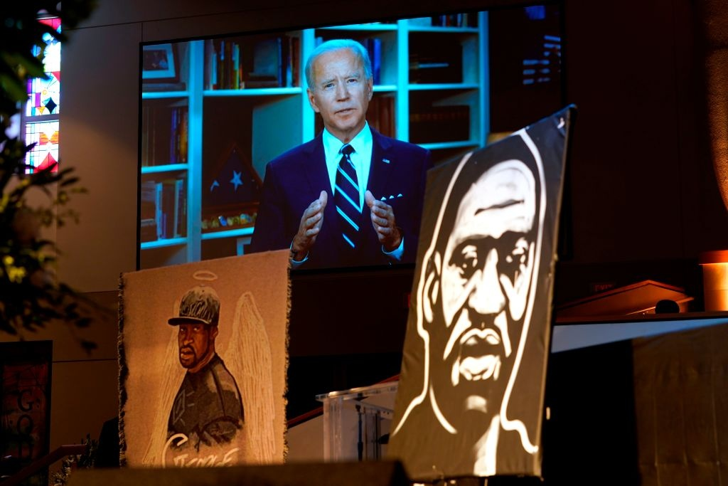 Democratic presumptive presidential candidate and former Vice President Joe Biden speaks via video link as family and guests attend the funeral service for George Floyd at The Fountain of Praise Church on June 9, 2020, in Houston.