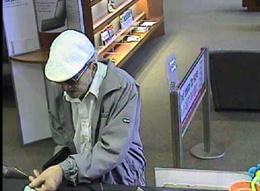 Bank surveillance photographs from the U.S. Bank, 14837 Pomerado Road, Poway, California, June 7, 2010.