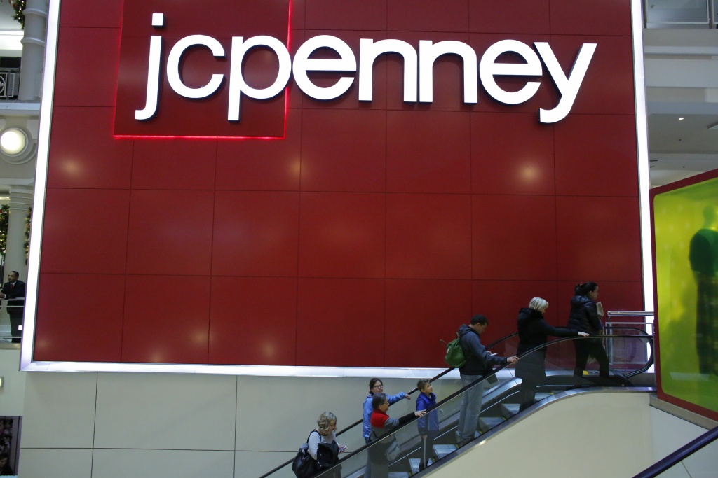 In this file photo, people exit from JCPenny store at Herald Square on November 25, 2016, in New York. The company said Friday it will close 130-140 stores and two distribution centers and offer early retirement to about 6,000 employees in a bid to improve profitability.