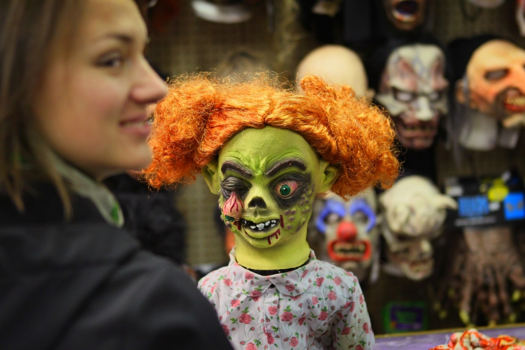A customer shops for a Halloween mask at Fantasy Costumes on October 28, 2011 in Chicago, Illinois. The store is open around the clock through Halloween to help keep up with customer demand.