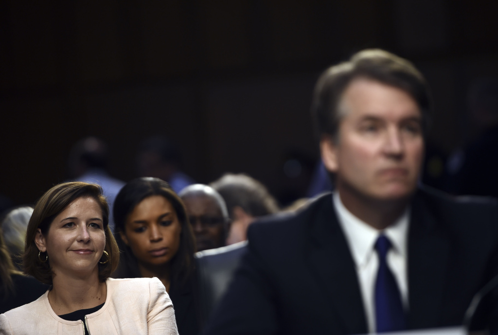 US Supreme Court nominee Brett Kavanaugh listens during the first day of his confirmation hearing in front of the US Senate on Capitol Hill in Washington DC, on September 4, 2018 as his wife Ashley Estes Kavanaugh looks on.