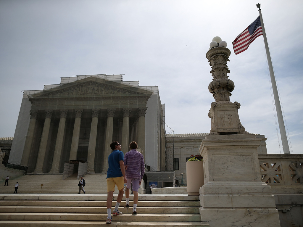 People walk near the U.S. Supreme Court building in June.