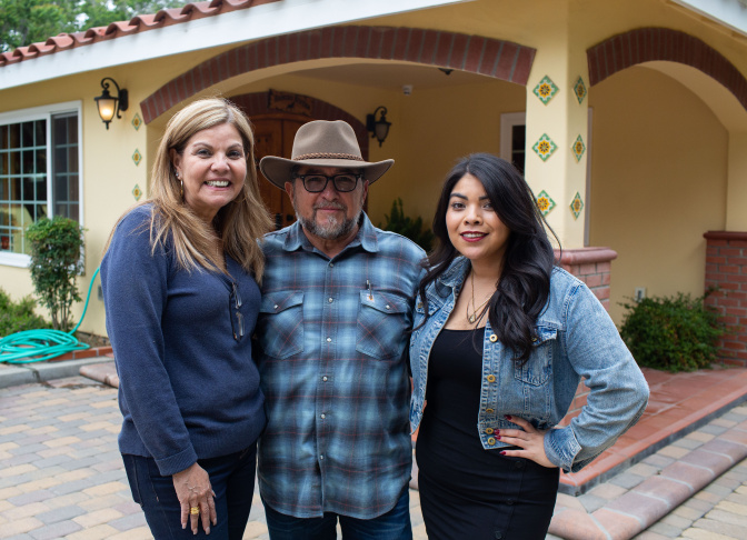 Helen, Juan, and Monica Rivera in front of Juan and Helen's home, on May 26, 2019 in Chino, California. (James Bernal for KPCC)