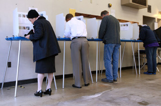 Voters fill out ballots at a polling place in a fire station June 8, 2010 in Oakland, California.