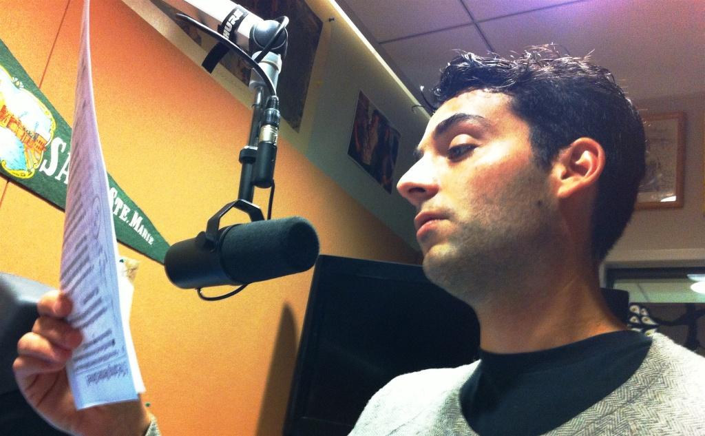 LA Weekly staff writer Hillel Aron reading his script in the Off-Ramp studio.