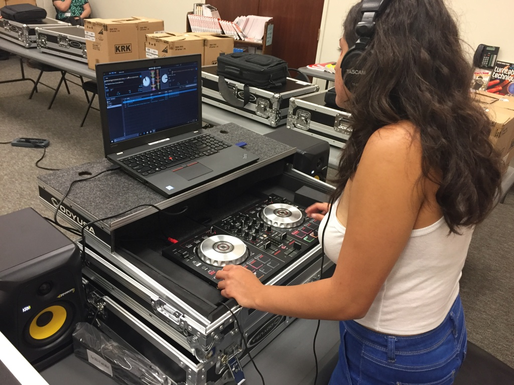 DJ Sol a.k.a. 20-year-old Adriana Medina works on her mix at the Compton public library.